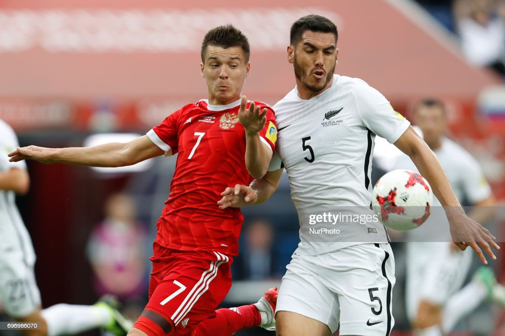 Dmitry Poloz (L) of Russia national team and Michael Boxall of New Zealand national team during the Group A - FIFA Confederations Cup Russia 2017 match between Russia and New Zealand at Saint Petersburg Stadium on June 17, 2017 in Saint Petersburg, Russia.