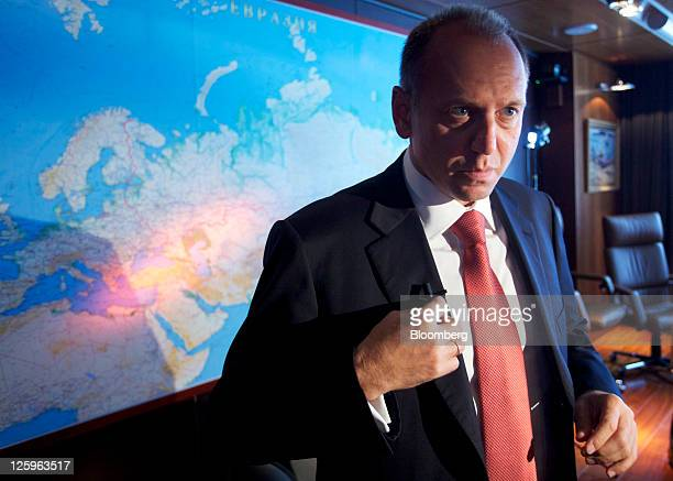 Dmitry Pumpyansky chairman of OAO TMK adjusts a microphone during an interview at the company's headquarters in Moscow Russia on Thursday Sept 22...
