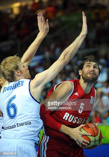 Dmitry Sokolov of Russia vies with Kimmo Muurinen of Finland during the EuroBasket 2013 Group D match between Finland and Russia in Koper on...