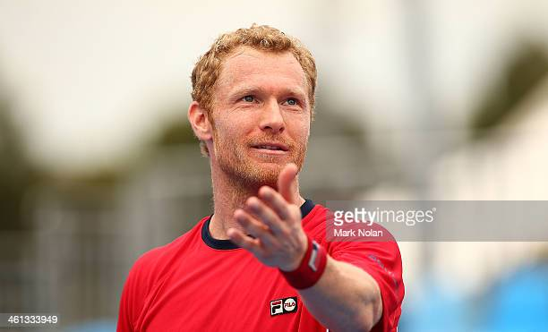 Dmitry Tursunov of Russia disputes a call in his match against Lukas Rosol of the Czech Republic during day four of the 2014 Sydney International at...