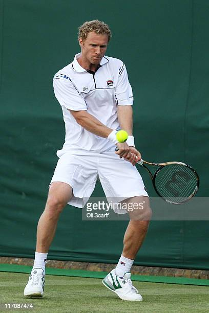 Dmitry Tursunov of Russia hits a backhand during his first round match against Ernests Gulbis of Latvia on Day Two of the Wimbledon Lawn Tennis...