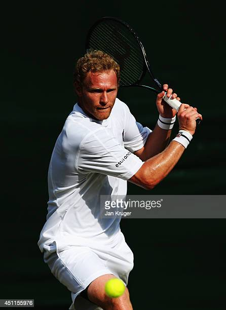 Dmitry Tursunov of Russia in action during his Gentlemen's Singles first round match against Denis Istomin of Uzbekistan on day two of the Wimbledon...