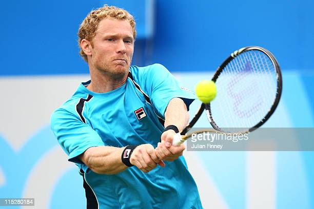 Dmitry Tursunov of Russia in action during his Men's Singles first round match against Feliciano Lopez of Spain on day one of the AEGON Championships...