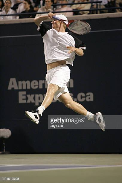 Dmitry Tursunov of Russia in action vs top seed Roger Federer at the Rogers Cup ATP Master Series tennis tournament at the Rexall Centre in Toronto...
