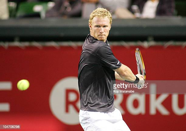Dmitry Tursunov of Russia plays a backhand during his match against Ernests Gulbis of Latvia during on day one of the Rakuten Japan Open at Ariake...