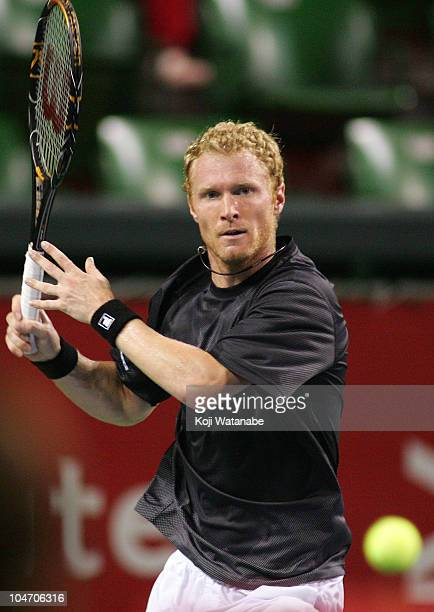 Dmitry Tursunov of Russia plays a forehand during his match against Ernests Gulbis of Latvia during on day one of the Rakuten Japan Open at Ariake...
