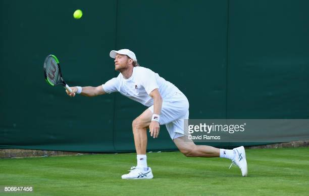 Dmitry Tursunov of Russia plays a forehand during the Gentlemen's Singles first round match against Fabio Fognini of Italy on day one of the...