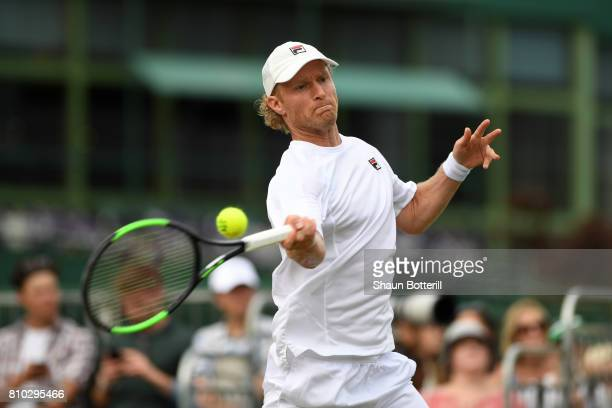 Dmitry Tursunov of Russia plays a forehand during the Mixed Doubles first round match against Adil Shamasdin of Canada and Maria Sanchez of the...