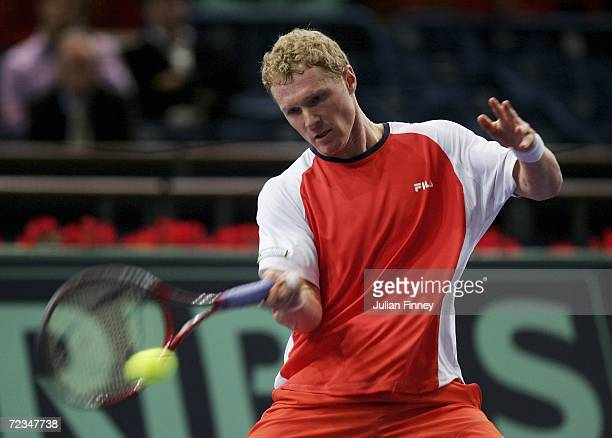 Dmitry Tursunov of Russia plays a forehand in his match against Nikolay Davydenko of Russia in the third round during day four of the BNP Paribas ATP...
