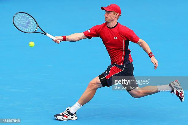 Dmitry Tursunov of Russia plays a forehand in his semi final match against Juan Martin Del Potro of Argentina during day six of the Sydney...