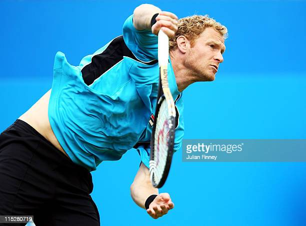 Dmitry Tursunov of Russia serves during his Men's Singles first round match against Feliciano Lopez of Spain on day one of the AEGON Championships at...