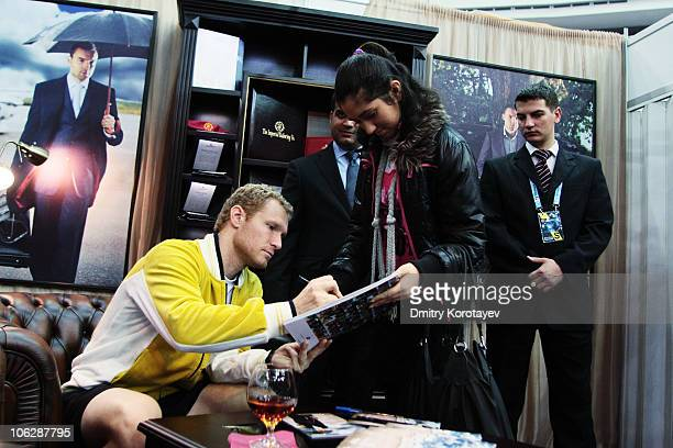 Dmitry Tursunov of Russia signs his autograph for a fan during day five of the International Tennis Tournament St Petersburg Open 2010 at the...