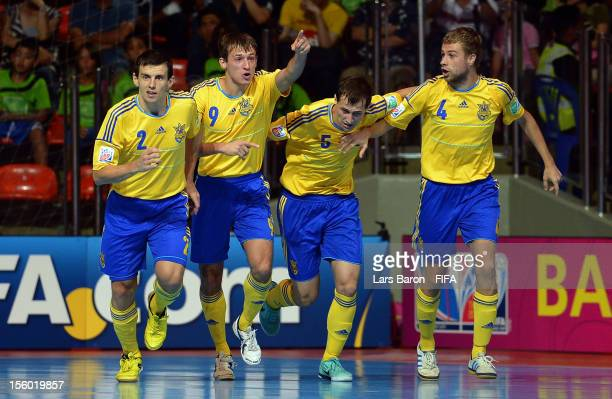 Dmytro Fedorchenko of Ukraine celebrates with team mates after scoring his teams second goal during the FIFA Futsal World Cup Round of 16 match...