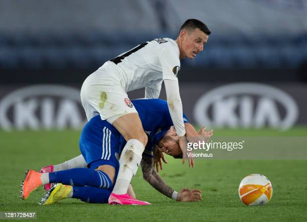 Dmytro Ivanisenia of FC Zorya Luhansk and James Maddison of Leicester City in action during the UEFA Europa League Group G stage match between...