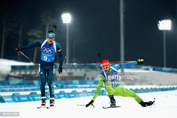 Dmytro Pidruchnyi of Ukraine and Lenart Oblak of Slovenia lunge for the finish line during the Men's 4x75km Biathlon Relay on day 14 of the...