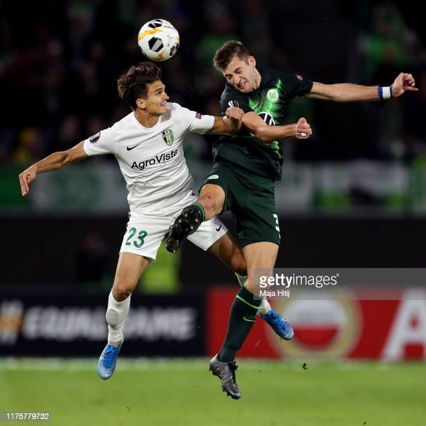 Dmytro Shastal of Oleksandriya and Robin Knoche of VfL Wolfsburg during the UEFA Europa League group I match between VfL Wolfsburg and FC...