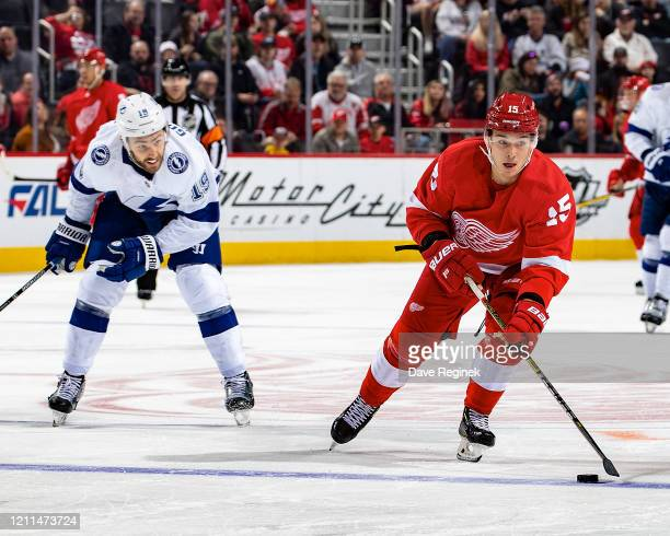 Dmytro Timashov of the Detroit Red Wings skates up ice with the puck next to Barclay Goodrow of the Tampa Bay Lightning during an NHL game at Little...