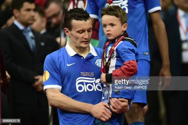 Dnipro Dnipropetrovsk's Artem Fedetskiy and his son following his team's defeat