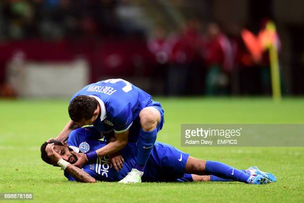 Dnipro Dnipropetrovsk's Artem Fedetskiy checks teammate Matheus after he passes out following a collision