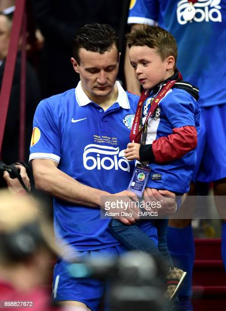 Dnipro Dnipropetrovsk's Artem Fedetskiy walks down the steps dejected after collecting his losers medal