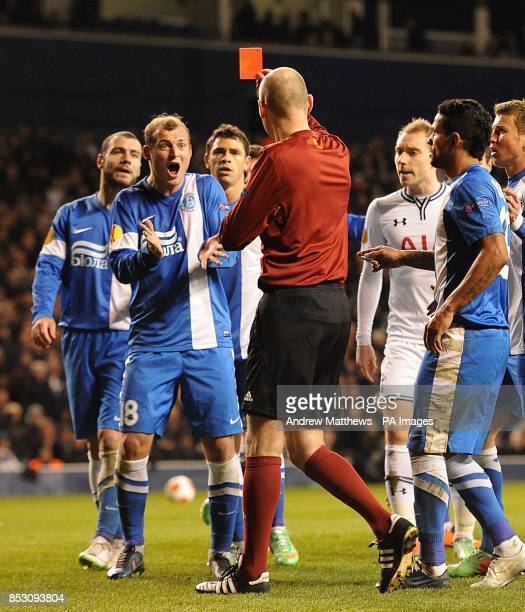 Dnipro Dnipropetrovsk's Roman Zozulya reacts after being shown a red card by referee Antony Gautier following a clash with Tottenham Hotspur's Jan...