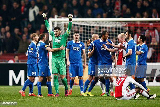 Dnipro players celebrate as they advance to the next round on away goals during the UEFA Europa League Round of 16, second leg match between AFC Ajax...