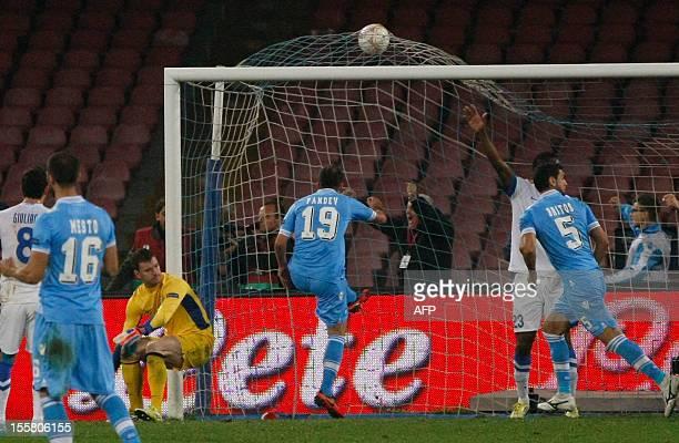 Dnipro's goalkeeper Jan Lastuvka looks as Napoli's Goran Pandev scores a goal during the UEFA Europa league Group F football match SSC Napoli vs...