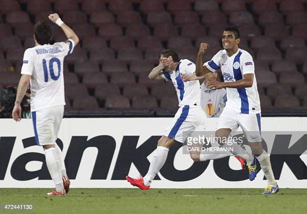 Dnipro's players celebrate after scoring during the UEFA Europa League semi final first leg football match SSC Napoli vs FK Dnipro Dnipropetrovsk on...