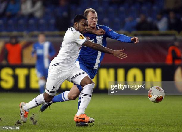 FC Dnipro's Roman Zozulya and Tottenham Hotspur FC's Ezekiel Fryers during the UEFA Europe League round of 32 football match Dniepropetrovsk vs...