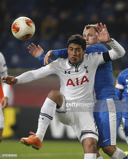 Dnipro's Ukrainian forward Roman Zozulya and Tottenham Hotspur FC 's Brazilian defender Paulinho vie for the ball during the UEFA Europe League round...