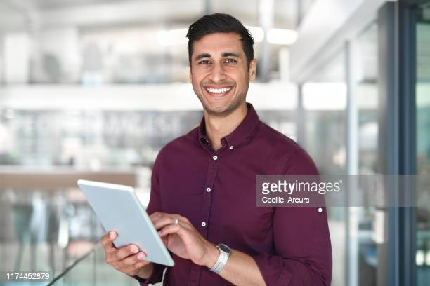 i do all my work on this device - indian ethnicity stock pictures, royalty-free photos & images