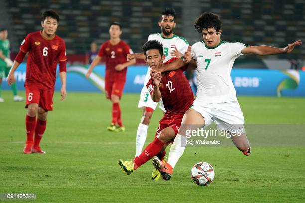 Do Duy Manh of Vietnam and Safaa Hadi AlFuraiji of Iraq compete for the ball in action during the AFC Asian Cup Group D match between Iraq and...