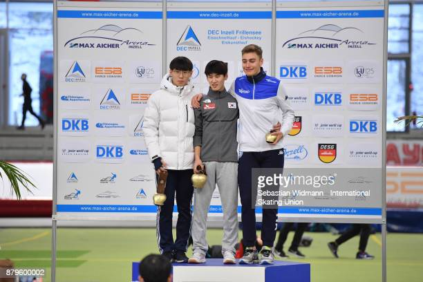 Do Hyung Lee and Hae Young Lee of South Korea and Francesco Betti of Italy pose during the medal ceremony of the Men 1500 Meter at the ISU Junior...