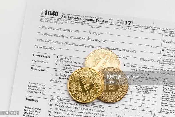 do i need to declare bitcoins? - 1040 tax form stock photos and pictures