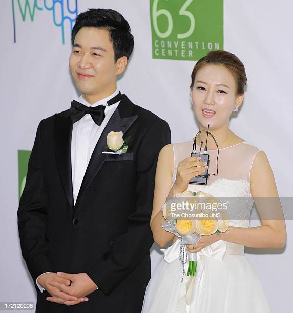 Do KyungWan and Jang YoonJung pose for photographs before their wedding at 63 building convention center on June 28 2013 in Seoul South Korea