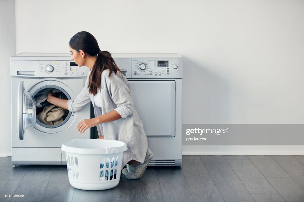 I do my laundry once a week : Stock Photo