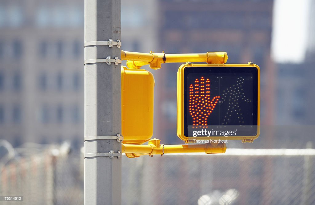 Do not cross sign on traffic lights, close-up : Stock Photo