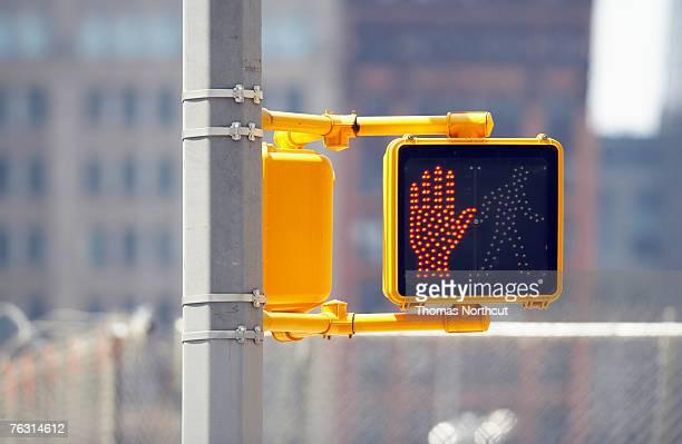 Do not cross sign on traffic lights, close-up