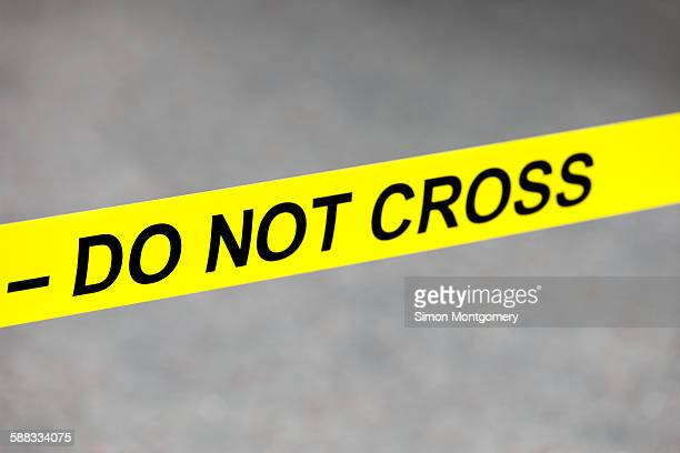 do not cross tape - 待避所標識 ストックフォトと画像
