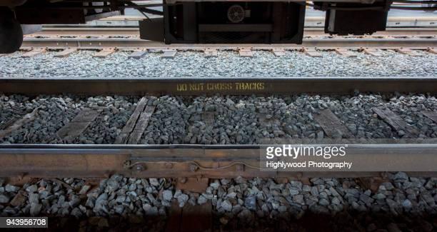 do not cross tracks - highlywood fotografías e imágenes de stock