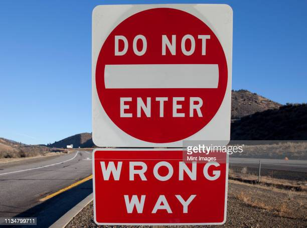 do not enter and wrong way signs - wrong way stock pictures, royalty-free photos & images