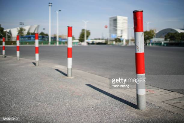 do not enter road by white and red pole - bollard stock photos and pictures