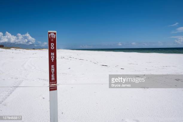 do not enter sign on the beach - brycia james stock pictures, royalty-free photos & images