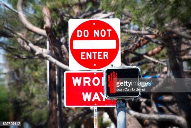 do not enter wrong way street signs - wrong way stock pictures, royalty-free photos & images