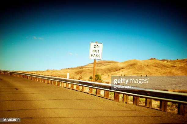 do not pass sign along rural highway - 待避所標識 ストックフォトと画像