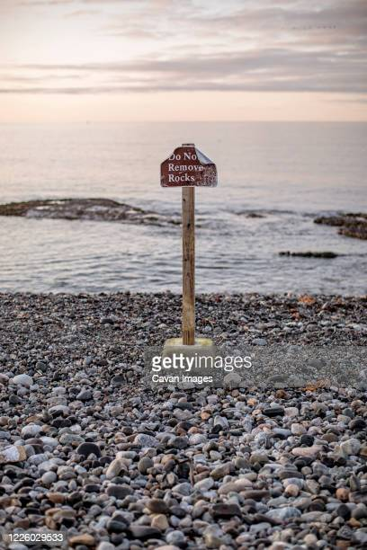 do not remove rocks sign at seawall beach acadia national park, maine - seawall stock pictures, royalty-free photos & images