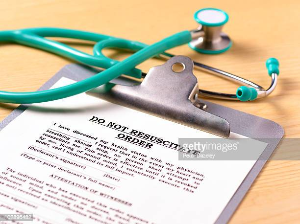 do not resuscitate order form on clipboard - euthanasia stock pictures, royalty-free photos & images