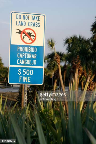 A do not take land crab sign at North Hutchinson Island