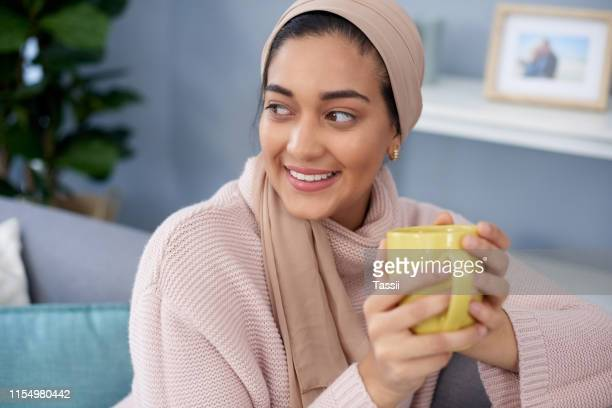i do quite enjoy these quiet moments with coffee - hot arab women stock photos and pictures