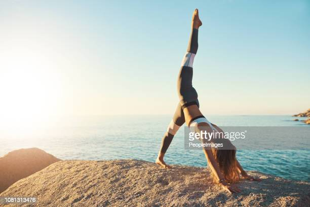 do yoga a get in the best shape - handstand stock pictures, royalty-free photos & images